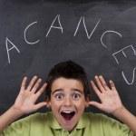 Boy with chalkboard — Stock Photo #34968979