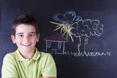 Boy with chalkboard — Stock Photo