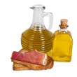 Stock Photo: Bottles of oil and ham