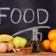 Stock Photo: Balanced diet products with blackboard