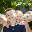 Stock Photo: Group of happy children smiling at camera