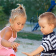Stock Photo: Lovely little children playing in sandbox