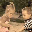 Stock Photo: Lovely little children playing in the sandbox