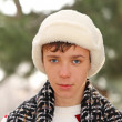 Stock Photo: Handsome teen boy in white fur hat