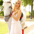 Stock Photo: Beautiful lady with white horse