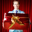Man with the gift — Stock Photo #7938238