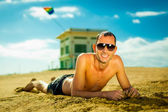Sexy young man at the beach — Stock Photo