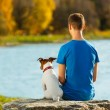 Boy and dog — Stockfoto