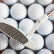 Golf putter and balls — Stock Photo