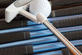 Golf putter and golf clubs — Stock Photo