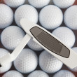 Golf putter and balls — Stock Photo #24519293