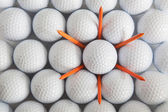 Golf balls and tees — Stock Photo