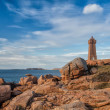 Stock Photo: Old lighthouse on impressive coast in Brittany