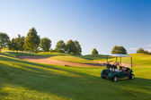 Green golf cart on the empty golf course — Stock Photo