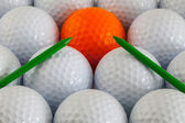 Golf balls and wooden tees — Photo