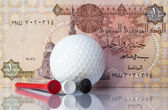 Egyptian money and golf equipments — Stock Photo