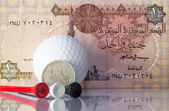 Egyptian money and golf equipments — Stock fotografie
