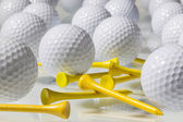 Many golf balls on a glass table — Stock Photo