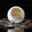 White golf ball and U.S. dollar coins — Stock Photo
