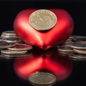 Red heart and U.S. dollar coins — Stock Photo