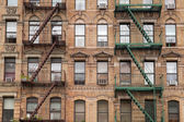 The typical fire stairs on old house in New York — Stock Photo