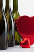 Bottles of wine and red heart — Stock Photo