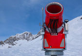 Modern red snow cannon in sunny day — Stock Photo