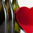 Bottles of wine and red heart — Stock Photo #39660589