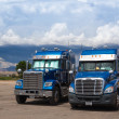 Stock Photo: UTAH - JULY 18: Two typical american blue Freightliner trucks o