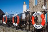 Lifebuoys of old fishing boats — Stock Photo
