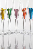 Glasses of champagne and golf equipments on a glass table — ストック写真