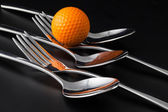 Forks and spoons on a black table — Stockfoto