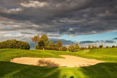 Summer golf course after storm at sunset — Стоковое фото