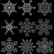 Set of drawn snowflake silhouettes — Stock Photo