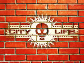 Brick wall with urban life sign — Stock Vector