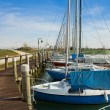 Boats in small port — Stockfoto