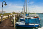 Boats in small port — Stock Photo