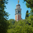 Bell tower with angel in Udine - Stock Photo