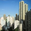 Skycrapers in Hong Kong with sun — Stock Photo