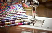 Sawing machine and fabrics — Stock Photo