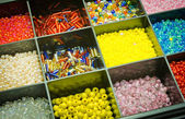 Box of colorful beads — Stock Photo
