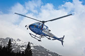 Helicopter leaving in mountain — Stock Photo
