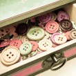 Vintage box of buttons — Stock Photo