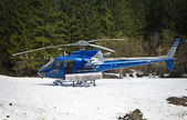 Helicopter resting on the snow — Stock Photo