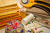 Many tools for patchwork in yellow — Stock Photo