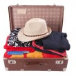 Stock Photo: Vintage leather suitcase overstuffed