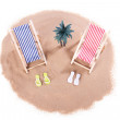 A small island with palm tree and two toy beach chairs — Stock Photo #29348789