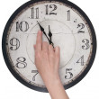 Female finger changes the time on a clock — Stock Photo #45986699