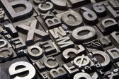Random arrangement of letterpress lead letters — Stock Photo