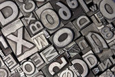 Random arrangement of letterpress lead letters — Foto de Stock